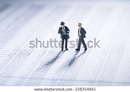 Two businessmen negotiating business terms