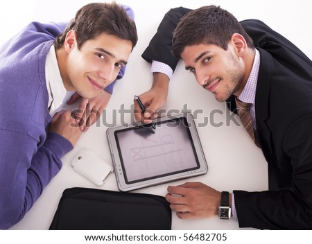 Two businessmen playing on tablet computer