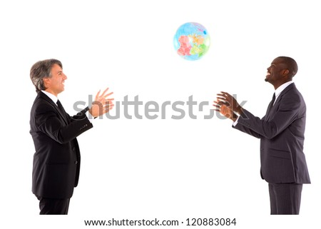 two businessmen playing with a globe