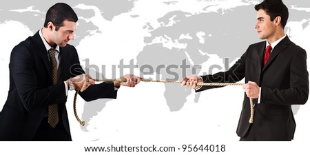 Two businessmen pulling a rope in front of a world map