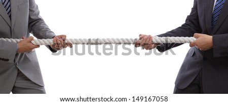 Two businessmen pulling tug of war with a rope concept for business competition, rivalry, challenge or dispute - stock photo