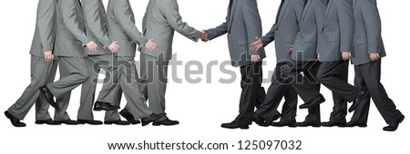Two businessmen shake hands in agreement and in mutual respect isolated on white