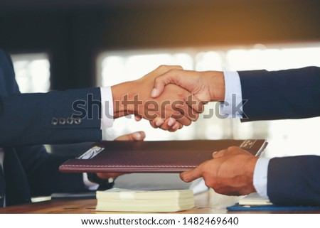 Two businessmen shake hands to congratulate the negotiation of agreements with business success. #1482469640