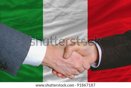 Two Businessmen Shaking Hands After Good Business Investment