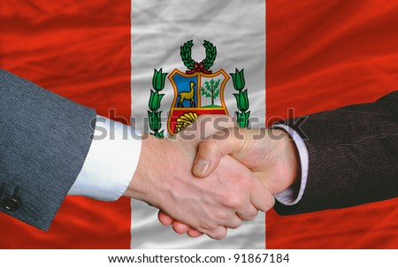 two businessmen shaking hands after good business investment  agreement in peru, in front of flag
