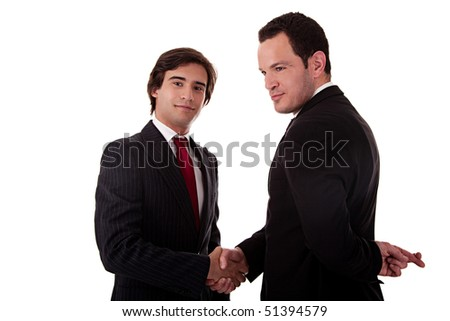 two businessmen shaking hands, and one businessman with his fingers crossed behind his back and smiling, isolated on white background