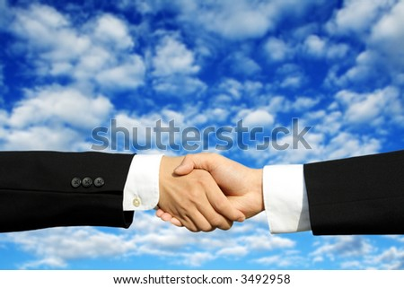 Two businessmen shaking hands on a successful deal