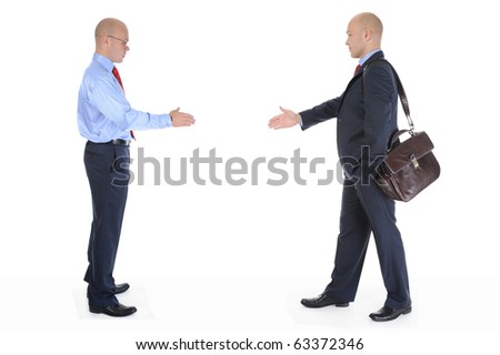 Two businessmen stretched out their hands for a handshake. Isolated on white background