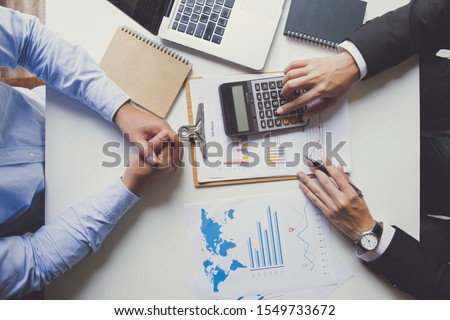Two businessmen talking about eligible investment, manager presenting financial report showing good work results to satisfied boss