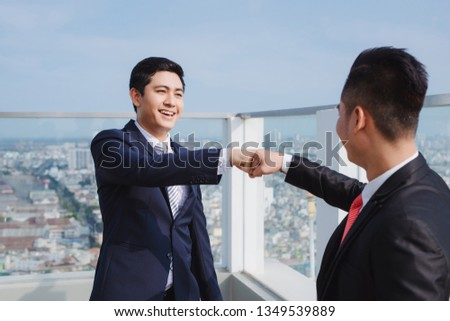 Two businessmen,two businessmen looking at the tablet and discussing the project and the economic weight.. Concept of: team, business, success, technology