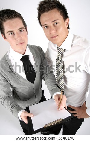 two businessmen with the contract looking at you