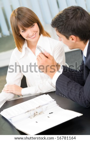 Two businesspeople working together at office