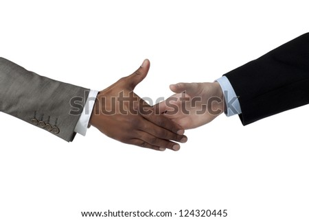 Two businessperson hands about to do a handshake over the white background