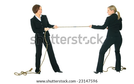 two businesswomen showing struggle face pulling rope with each another. concept for competition