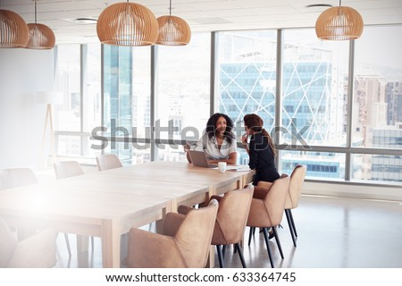 Two Businesswomen Using Laptop In Boardroom Meeting #633364745