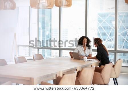 Two Businesswomen Using Laptop In Boardroom Meeting #633364772