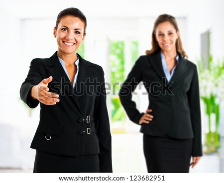 Two businesswomen welcoming you