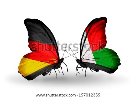 Two butterflies with flags on wings as symbol of relations Germany and Madagascar