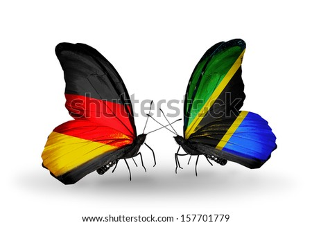Two butterflies with flags on wings as symbol of relations Germany and Tanzania