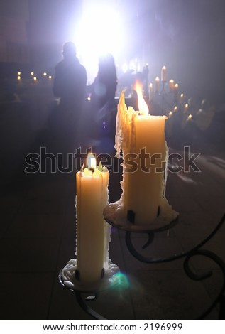 Two candles illumination a festive service - stock photo