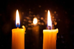 Two candles. Mourning. For the peace.