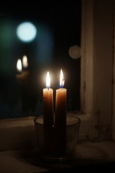 Two candles on windowsill