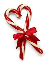 Two Candy Canes in Heart Shape with Red Bow Isolated on White Background.