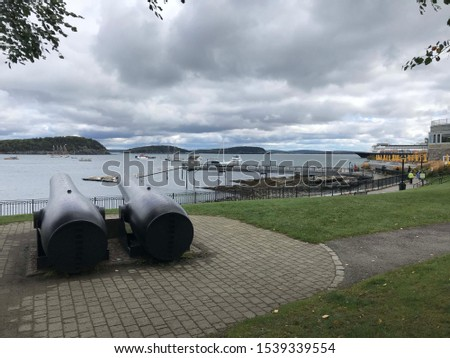 Two cannons facing the harbor of Bar Harbor, Maine. #1539339554