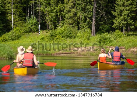 Two canoes approaching country border.