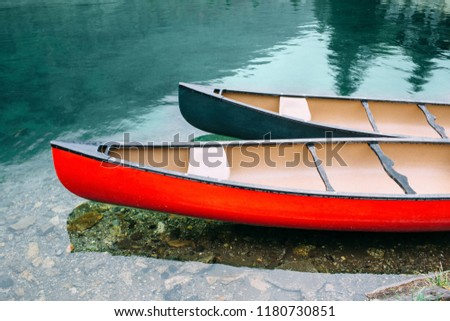 Two canoes floating peacefully on the clear Lake Champex, Switzerland