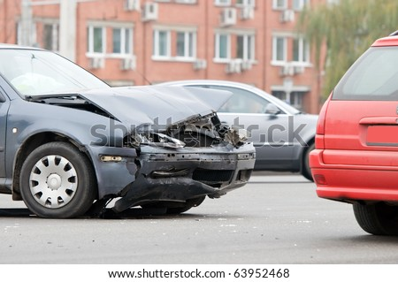 Two car crash accident on a road in city