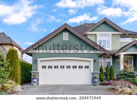 Two-car garage of a luxury house against blue sky in Vancouver, Canada