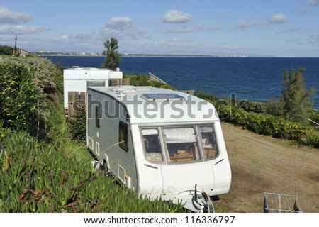 Two caravans at a sea side camping