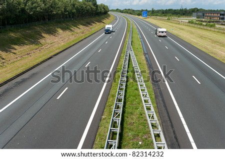 two caravans on an almost empty highway in vacation time
