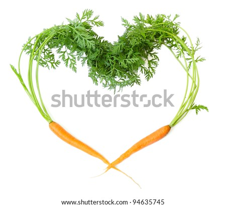 Two carrots in shape of heart on white background - stock photo