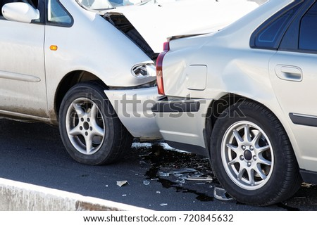 Two cars in a car accident on street. Closeup damaged automobiles after collision in city. Insurance case. #720845632
