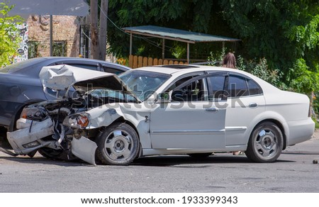 two cars on the road after the collision. Damaged white car on the road after the accident Stock photo ©