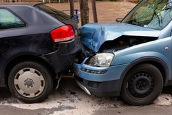 Two cars with metal damage after a rear-end collision