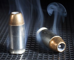 Two cartridges with hollow point bullets and smoke