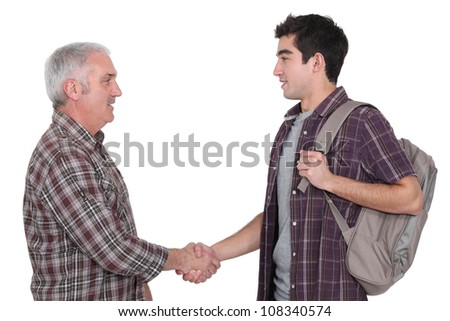 Two casual men shaking hands