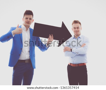 Two casual young business man holding arrow icon #1361357414