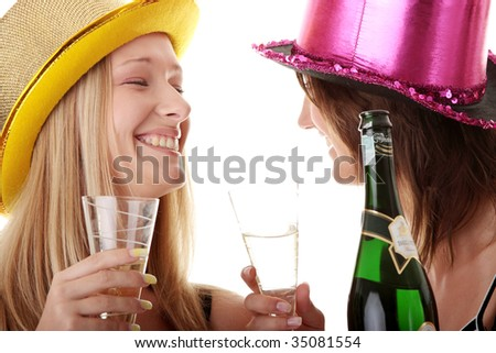 Two casual young women enjoying champagne in new years eve