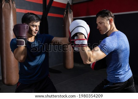 Two Caucasian Boxers Sparring in a Boxing Gym Foto stock ©