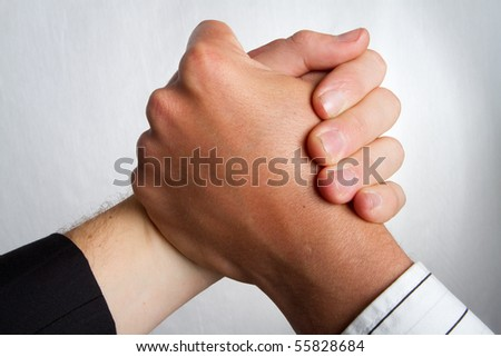 Two caucasian business partners holding hands