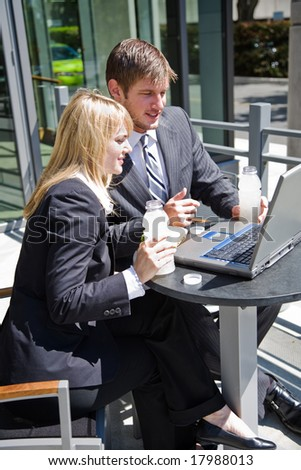 Two caucasian business people having a discussion during lunch hour