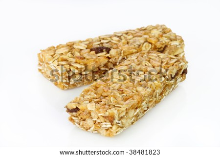 Two cereal bars on a bright background