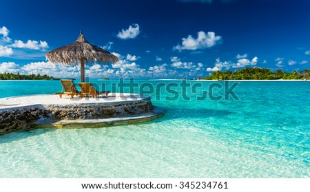 Two chairs and umbrella on a jetty on a tropical island, Maldives #345234761