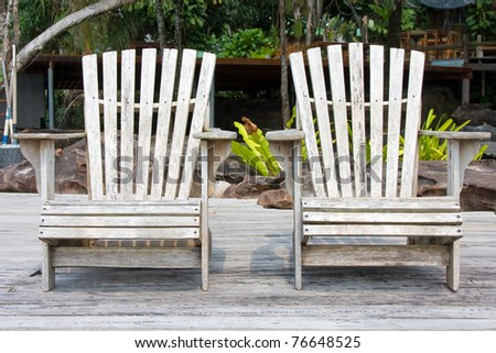 Two chairs by the beach shore in Thailand