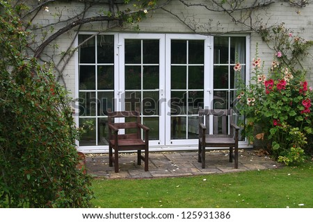Two chairs in garden - stock photo