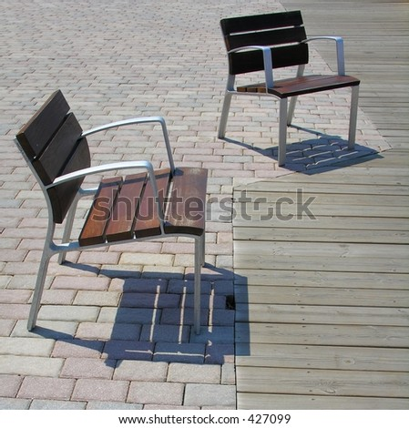 Two chairs on a promenade